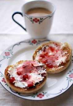 breakfast: coffee & english muffin with cream cheese and strawberry sauce