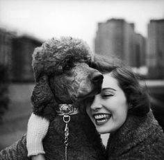 A woman with a dog sporting a Swiss watch on its collar, 1950s.