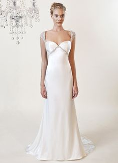 Sabrina style 3174  A Grecian-inspired silk charmuese gown features feminine beaded cap sleeves and intricate Swarovski crystal beading along the bust line. Shown in diamond white.