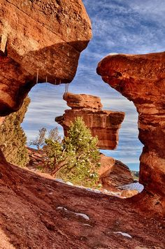 Awesome shot of one of the most beautiful places on earth. Balanced Rock in Garden of the Gods Park. .