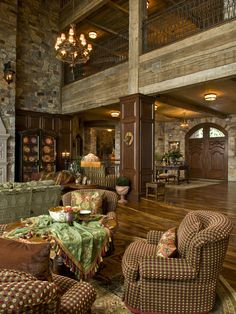Beautiful rustic great room! Love the combination of barn wood and stone and iron. Beautiful door with high windows.