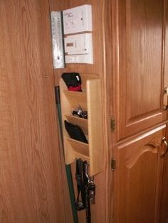 A junk rack for your RV using a wooden mail sorter mounted just inside the door of you pup camper rv? With limited space, it makes sense as a place to put your wallet, keys, cell phone - anything that is important that you want in a central location.