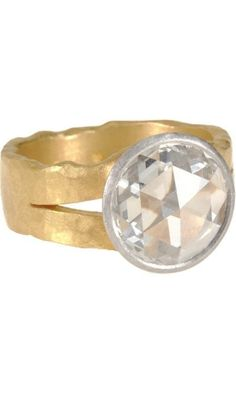 Malcolm Betts Diamond Split Band Ring: $57,600 Take a gander at the contrast between the perfectly rendered circle of diamond set against the roughness of the band...like Beauty and the Beast!   K.W.
