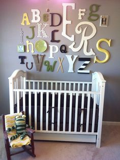 Alphabet wall. Idea for colors to compliment nursery decor instead of random primary colors