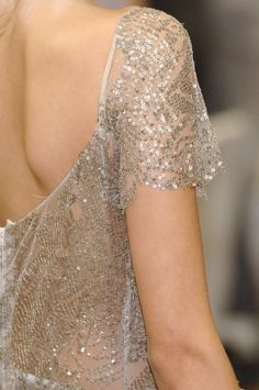 Love this subtly sexy back. No need for a plunging back which takes away from the imagination!