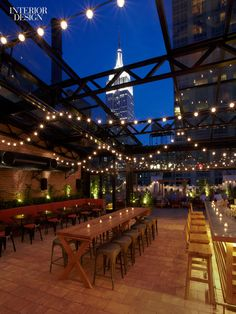 The interior of Refinery Hotel Rooftop, New York, features a reclaimed wood ceiling from the building's original water tower, a perfect bala...