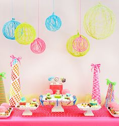 This project utilizes yarn, a glue mixture, and balloons – and is so versatile and budget-friendly. You can use these cool spheres for all sorts of parties and occassions… from birthday celebrations to baby showers, bridal showers, and beyond! Nicolle created these particular yarn spheres for this super cute Holiday Whimsical Woodland Wonderland shoot: