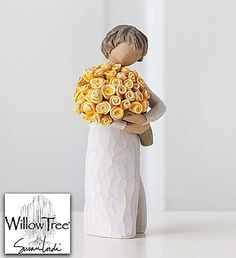 "Willow Tree® Keepsake - Good Cheer Share happiness with someone special! Crafted by the renowned artist Susan Lordi, for Willow Tree®, our ""Good Cheer"" figurine is a unique and special keepsake your recipient will treasure for years to come. This beautiful statuette of a woman cradling an oversized bouquet of sunny yellow roses—symbolizing friendship, optimism and well-being—makes a wonderful gift for friends who have achieved a goal, need a little lift… or for those who simply brighten our…"