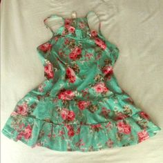 Floral print top Teal color with floral print top with Ruffles on the neckline and the hem. Looks great with a white pant for spring or summer! Excellent condition, worn once. No rips, stains or flaws at all. ❗️will donate if not sold soon❗️ Mossimo Supply Co. Tops