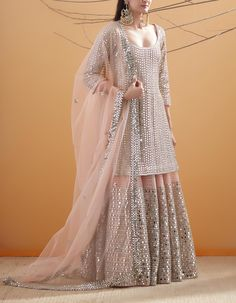 Then you've got to check out Abhinav Mishra's Mirror Work Lehengas from his 2019 spring summer collection. Party Wear Indian Dresses, Designer Party Wear Dresses, Pakistani Formal Dresses, Indian Bridal Outfits, Indian Gowns Dresses, Dress Indian Style, Kurti Designs Party Wear, Party Wear Lehenga, Pakistani Dress Design