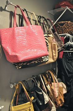 Use curtain rods in your closet to organize purses- where you can actually see and access them all! Genius!