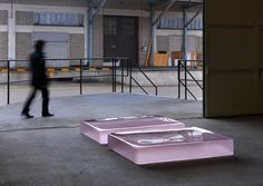 Two Pink Tons (D). Artist Roni Horn, 2008. Solid cast pink glass with as-cast surfaces on all sides (firepolished top), 2 units 22,9 x 101,6 x 152,4 cm each.