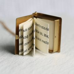 This exquisitely detailed little locket is a miniature book made from solid golden brass. Inside is a secret hidden message, specially folded and fitted inside the locket to look just like the pages of a real book! The locket has a perfectly working hinge and clasp and, if you wish, there is also space inside for you to add two tiny photographs. The front cover of the book is adorned with a tiny vintage copper love heart, in a rosy pink tone. The locket is a great size, measuring 3cm long…