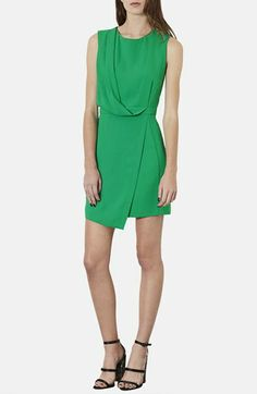 """Spring Pop of Color Lookbook Graceful draping and an asymmetric, faux-wrap design creates mod style in this woven dress. Keep it simple for the office or glam it up for your next night on the town.  36"""" length (size 8). Back zip closure. Partially lined. 100% polyester. Machine wash cold, lay flat to dry. By Topshop"""