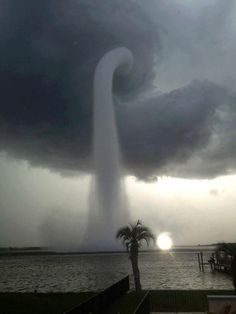 A waterspout (a non-supercell tornado that formed over water)