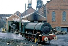 Amid the dross of a typical Yorkshire colliery, maintenance team gets busy filling the sandboxes; Steam Railway, British Rail, Steamers, Coal Mining, Slums, Steam Engine, Steam Locomotive, Great Britain, Yorkshire
