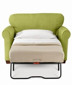 Twin bed pull-out great for a tiny home. And it's a beautiful green color, too.