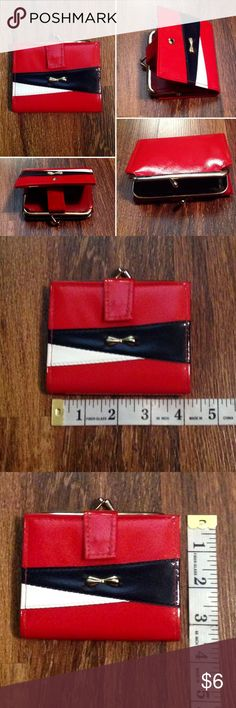 Vintage Red, White and Blue Wallet Refer to pictures for description and measurements. In great vintage condition. Has a tag inside from the seller. Never tried to remove it. Please ask any questions before purchasing. Thank you. Vintage Bags Wallets