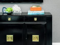 Dresser styled with books and coral