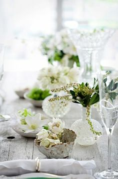 Elegant white table setting on nice smooth wood table