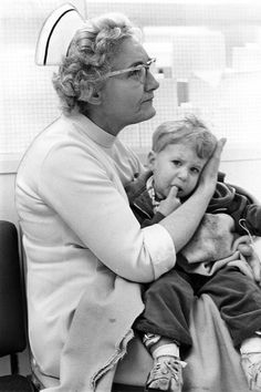 Clark College nursing instructor Veda DeColon, R.N., comforted Gill Steensen, as his mother Joan underwent surgery for her storm injuries.