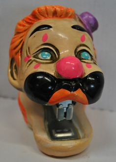 my dad would appreciate this..:)Vintage Holiday Fair Chalkware Clown Stapler 1969