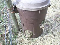 Fast, cheap, and easy hay feeder for goats. Diy Hay Feeder, Goat Hay Feeder, Pigmy Goats, Goat Playground, Fainting Goat, Goat Shelter, Goat Pen, Goat House, Goat Care