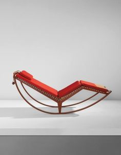 FRANCO ALBINI  Rocking chaise, model no. PS16  circa 1956  Walnut, fabric, cord, leather.  30 x 64 x 27 1/2 in. (76.2 x 162.6 x 69.9 cm)  Manufactured by Carlo Poggi, Pavia, Italy.