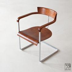 Halabala chair by Jindrich Halabala, 1935  (Czechoslovakia) Bauhaus style.  chrome-plated tubular steel, stained beechwood