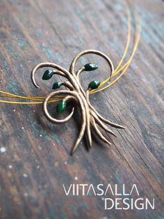 'Tree of Life II' - a bronze pendant with hand painted UV resin in shades of green. For sale at: https://holvi.com/shop/viitasalla/product/58f22e2e3fc104e924ada03c00ee137d/ #jewelry #jewellery #handmade #bronze #necklace