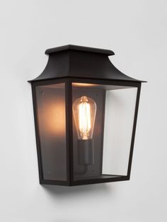 A traditonal style box wall light with a painted black finish and clear glass. Front Door Lighting, Overhead Lighting, Outdoor Wall Lighting, Sconce Lighting, Exterior Wall Light, Exterior Lighting, Custom Lighting, Shop Lighting, Victorian Wall Lighting