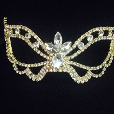 Quantities : 1 PC Color : silver rhinestone Size :5 wide x 2 tall Weight : 2.8 oz       You can decode with flower , feathers to create your own mask .