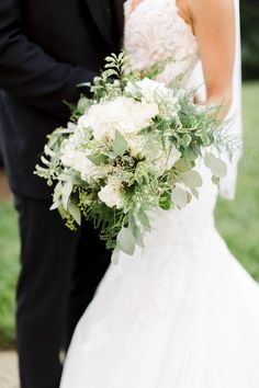 Benkens #bridalbouquet with #hydrangea #roses #greenery #silverdollareuc #cascade #bride #cincinnatiohio #nortgernky #wedding #weddingflowers #florist #flowers picture by Olivia Hatfield Photography