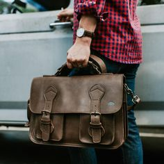 The Denver Leather Belted Briefcase is back in a new form: full grain leather. Professional and rugged just like you, this full grain leather briefcase was born to stand out. Cowhide Leather, Cow Leather, Suede Leather, Black Leather, Leather Duffle Bag, Leather Briefcase, Leather Bags, Duffle Bag Travel, Duffle Bags
