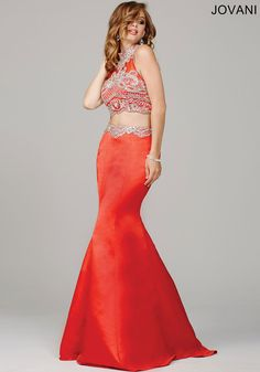 Gorgeous two-piece mermaid dress features an open back and crystal embellished top