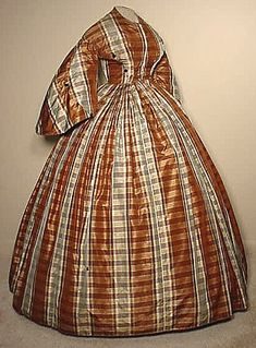 I really like this one. the colors, the style... Civil War era silk day dress.