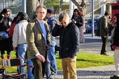 Actor Jeremy Irons, Director Bille August and crew having a break during the shooting of the film Night Train to Lisbon. Belém Ferry Terminal in Lisbon, Portugal.