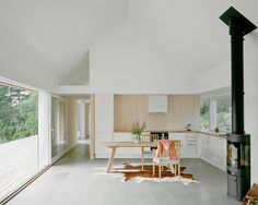 Summer house in Sweden by architect Mikael Bergquist with timber walls that will fade to grey. Sweden House, Retreat House, Timber Walls, Minimalist Kitchen, Bungalows, Contemporary Architecture, Home Kitchens, House Plans, Sweet Home