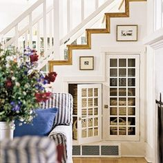 under stair storage, see we can make the dog kennel under the stairs something after we move out