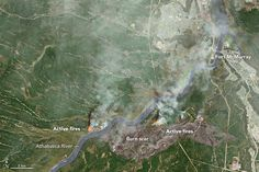 News - Satellites zoom-in on Fort McMurray wildfires from space - The Weather Network  nfrared, near infrared and green light images are combined here from Landsat 8, taken on May 3, 2016, to penetrate the clouds and reveal burn scars and hot spots. Credit: NASA Earth Observatory