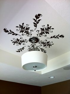 Another idea I would never have thought of - vinyl on the ceiling as a medallion around a light. If you arent a vinyl person, stencils by delia