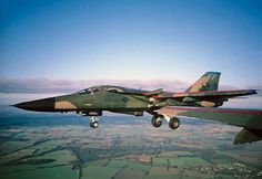 A USAF General Dynamics F-111 Aardvark with its gear down.
