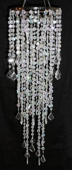 Faux crystal chandelier. something like this over the tables. they could hang from a canopy. would be so pretty with gold flecks in it too