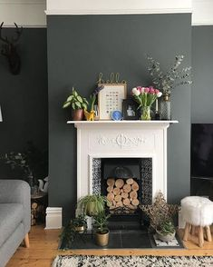 Dark Grey Walls with White Fireplace and Wooden Flooring White Fireplace, Living Room With Fireplace, Living Room Grey, Interior Design Living Room, Home And Living, Living Room Designs, Fireplace Design, Logs In Fireplace, Dark Wooden Floor Living Room