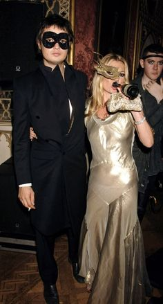 Kate Moss wears Stella McCartney dress with Philip Treacy mask with Pete Doherty