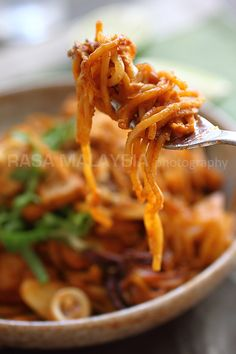 Indian Mee Goreng from Rasa Malaysia. Part of Andy + Elise's Asian food week this week.   We leave out the squid (mainly because its not easy to find), use sambal oelek instead of ketchup, and store bought chilli paste.