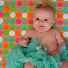 Use wrapping paper as backdrop for baby pics