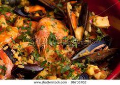 Sold at Shutterstock! Spanish paella, traditional recipe from Valencia. by eZeePics Studio, via ShutterStock