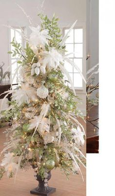 White Christmas - I love shorter trees in urns.  Would go great on either side of the front door in the foyer.
