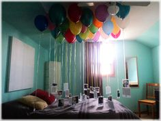 omg cutest birthday idea ever. balloons for the number of years, pictures attached (and numbered) of the age of that number. picture #1, 1 year old etc. what a way to wake up :)